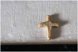 Small cross above doorway