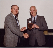 Receiving Distinguished Service Award from the Expert Committee on Weeds 1994