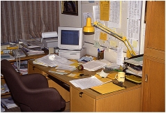 Cluttered office desk in Room 416C in 1993