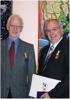 Receiving Alberta Centennial Medal from MLA Ray Prins in 2005